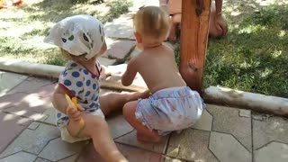 Children decide who will play with an interesting piece of paper