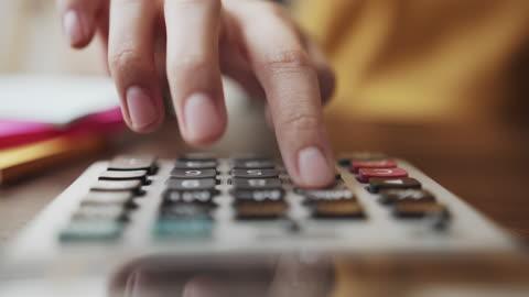 Woman's Hand Pressing Calculator
