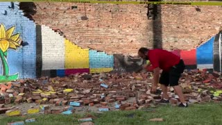 An old wall in Toledo, Ohio that was the site of a George Floyd mural collapsed and fell apart.