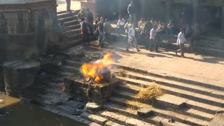 Pyre funeral ceremony, burning a corpse in Bagmati River, Pashupatinath Temple, Kathmandu 5