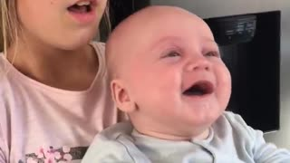 Baby hysterically laughs at totally random object