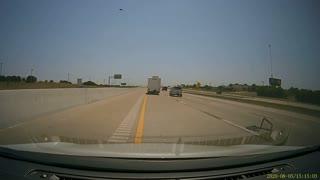 RV Door Springs into Car on Highway