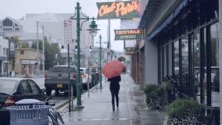 Street Rainy Walking With Orange Umbrella