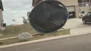 Trampoline Blowing in the Wind Hits Car