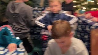 Grandkids opening Christmas gift
