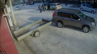Man Hauling Trailer Loses Control Around Icy Corner
