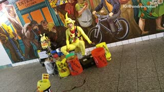 Man yellow chicken outfit playing drums