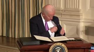 Joe Biden Trying to Put Pen in Jacket Pocket