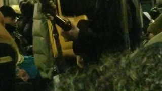 Guy sings and plays his guitar on subway
