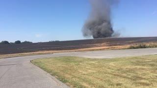 Tornado Forms From Field Fire