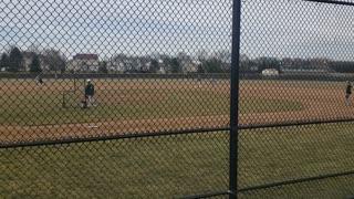 Logan hitting at baseball practice 2021