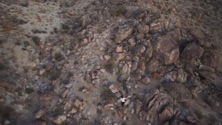 People Climbing Rocky Desert Mountain