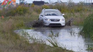 car racing in dirty water and slash