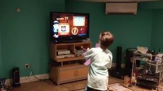 Spencer playing fruit ninja VID_20180707_201047