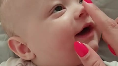 A very cute baby get sleep when you push the button