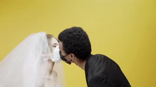 Newly Wed Couple Kissing While Wearing Masks