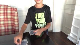 Kids does card magic trick