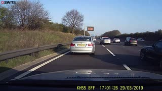 Driver stops on motorway while young boy has a wee