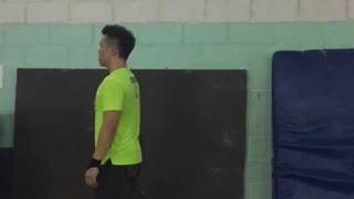 Guy neon green shirt backflip gymnastics fail