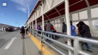 UN officials escorting migrants across US border