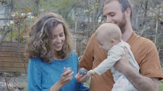 Happy Family Outside with baby