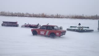 Serviceman Playing With Old Datsun Race Car In Snow