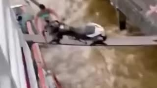 Pushing a motorcycle into a boat on a narrow board ....!!!