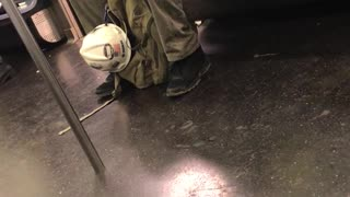 Construction worker clipping finger nails