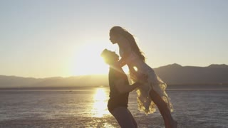 Couple dancing on sunset background great video