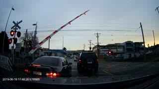 Car Gets Caught Under a Gate