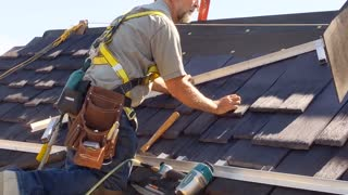 Father with Parkinson's Repairs Roof with Daughter