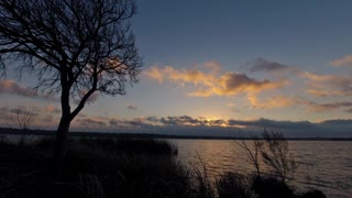 Breaking Sunrise Over a Lake