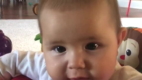 Teething Baby Goes To Town On Jumper