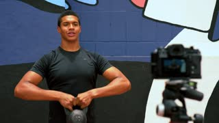 Fitness influencer in front of a camera giving a tutorial