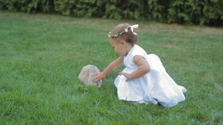 Beutiful Little Girl Playing With Rabbit