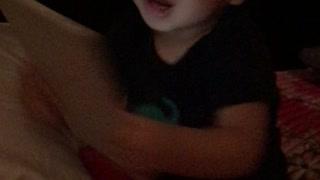 Cute baby watching YouTube on iPad