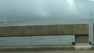 Driving Towards a Huge Rolling Storm
