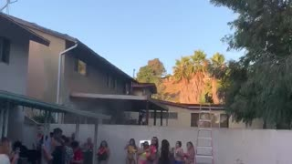 Girl Jumping into Pool From Roof Falls Short