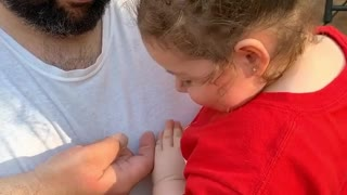Sweet little girl is so brave to hold an inchworm