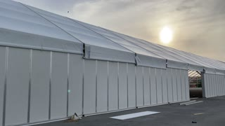 Installation of a large tent outside view