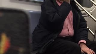 Man in red button up brushes teeth on subway