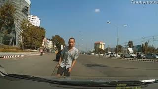 Driver Avoids Peculiar Man in Traffic