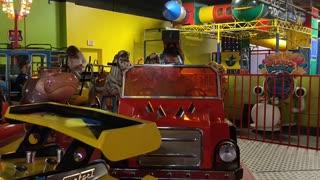 Spencer driving cars at Chuck e Cheese VID_20180422_143938