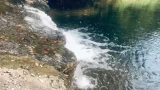 The sound of dropping water against the rocks.