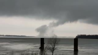 Strange looking tornado forms over the Mississippi River