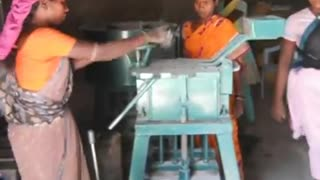 womens working in factory making construction items