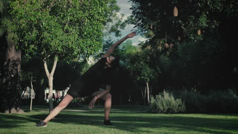 Girl doing stretching in nature