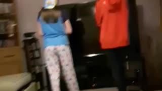 Dancing girl throws bucket