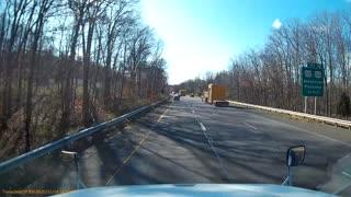 Semi Truck Loses Panel on Highway