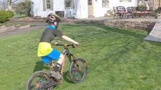 Boy Races Through Homemade BMX Track